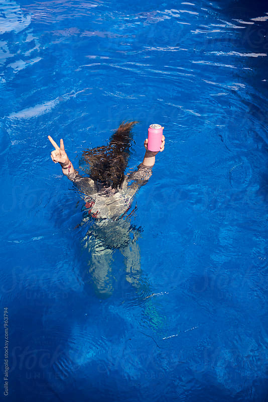 Unrecognizable person showing peace sign while underwater by Guille Faingold for Stocksy United