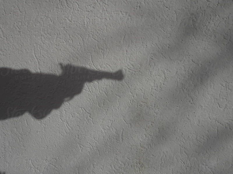 Shadow with a gun by rolfo for Stocksy United