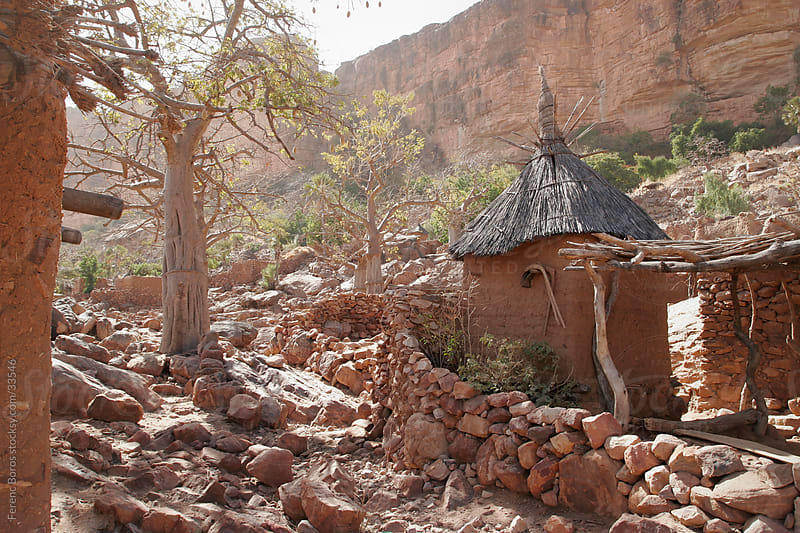 Granaries with thatched roof in a Dogon village at the foot of B by Ferenc Boros for Stocksy United