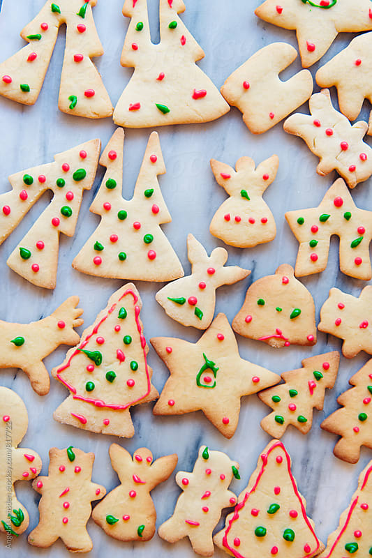 Christmas cookies viewed from above by Angela Lumsden for Stocksy United