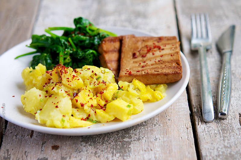 Grilled tofu with mango and chilli crushed potatoes by Harald Walker for Stocksy United