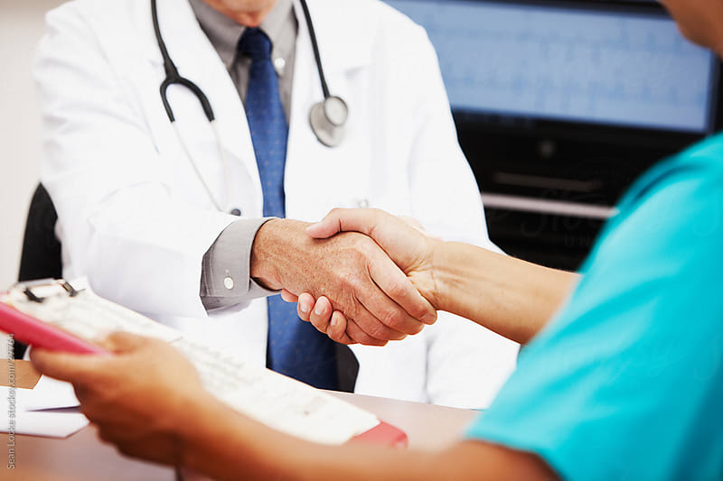 Doctors: Physicians Shake Hands by Sean Locke for Stocksy United