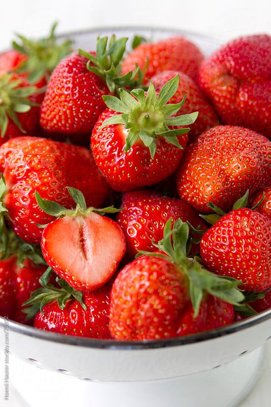 Strawberries in white colander by Noemi Hauser for Stocksy United