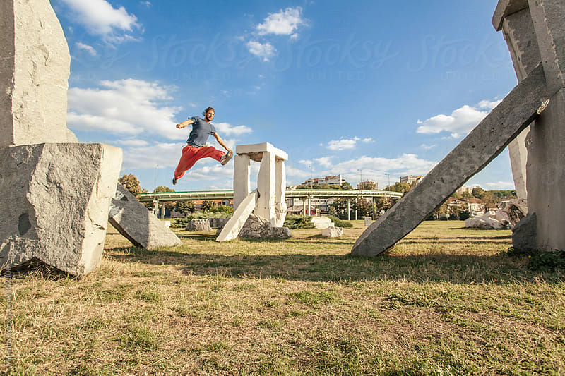 Man Practicing Parkour in the Park by Mosuno for Stocksy United