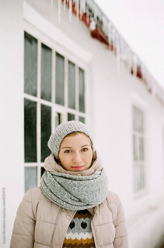 Portrait o young woman in winter  by Lyuba Burakova for Stocksy United