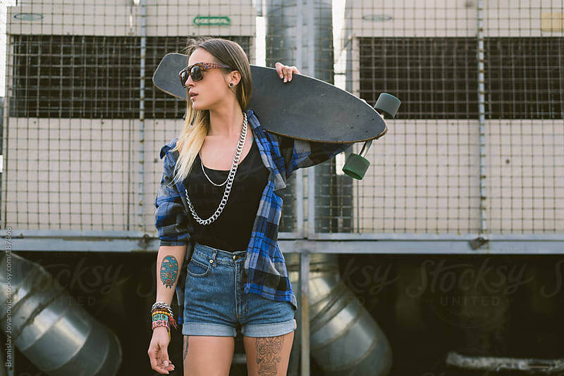 Urban woman with longboard by Branislav Jovanovic for Stocksy United