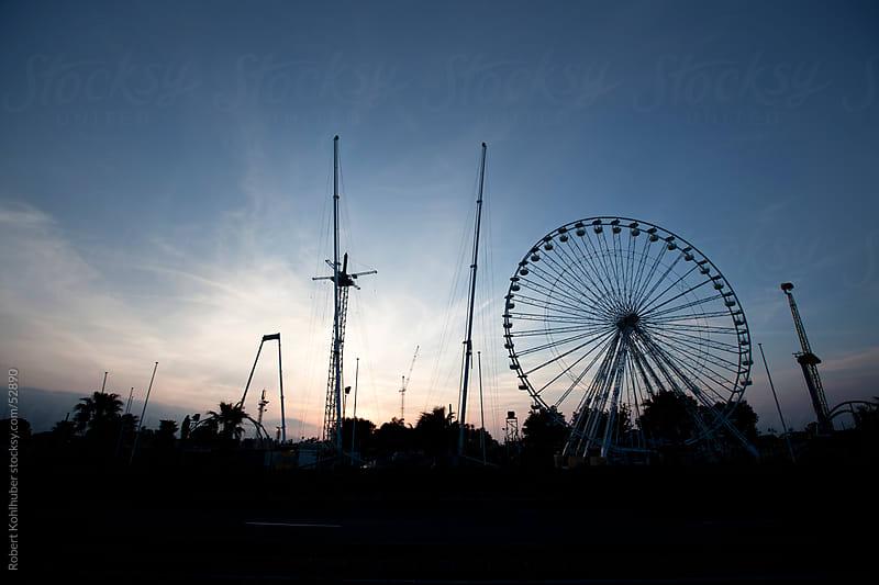 Amusement park at dusk by Robert Kohlhuber for Stocksy United