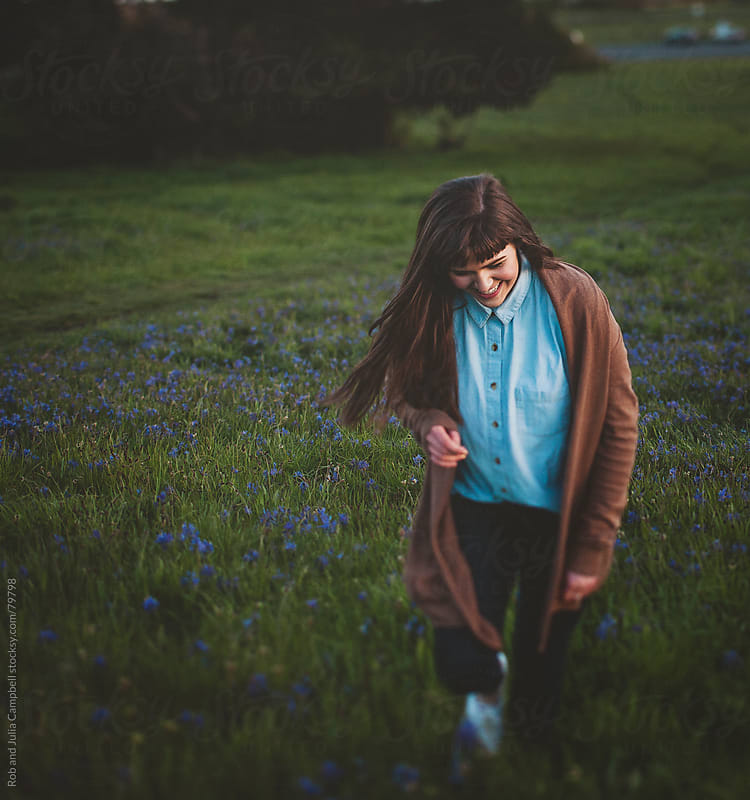 Beautiful teen girl enjoying nature at sunset by Rob and Julia Campbell for Stocksy United