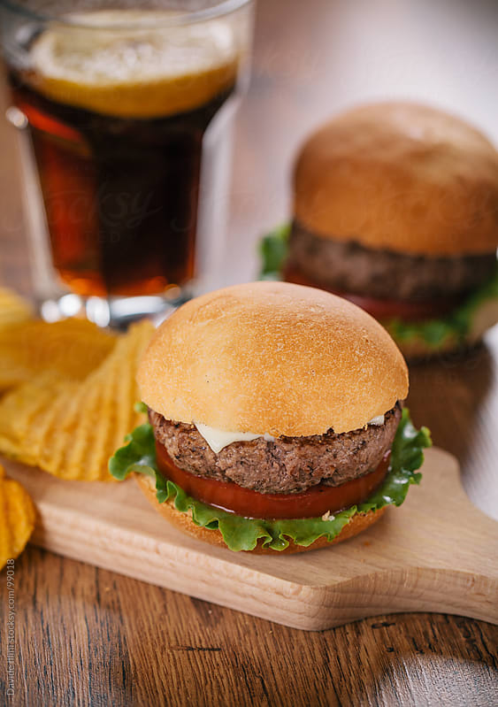 Fresh Hamburger with Chips and Cola. by Davide Illini for Stocksy United