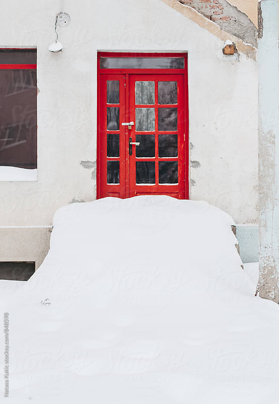 Red snowed door and stairways  by Natasa Kukic for Stocksy United