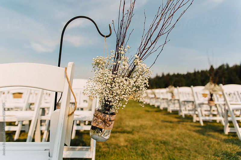 Baby's breathe wedding decoration hanging in the aisle. by Jessica Byrum for Stocksy United