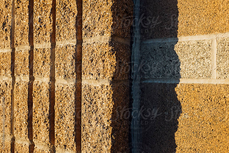 Detail of concrete  building wall and shadows, close up by Paul Edmondson for Stocksy United