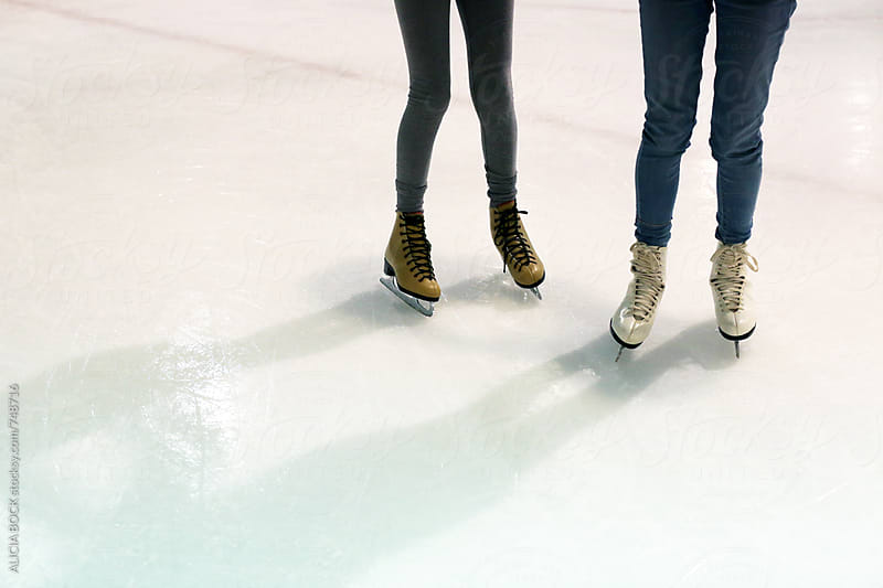 The Legs Of Two Girls Ice Skating by ALICIA BOCK for Stocksy United