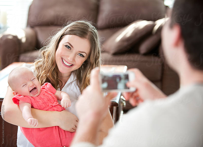 Baby: Happy Baby Saying Cheese for a Picture by Sean Locke for Stocksy United