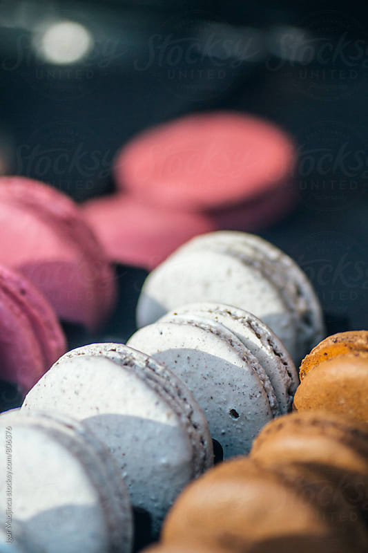 Colorful and tasty macaroons in natural light close up by Igor Madjinca for Stocksy United