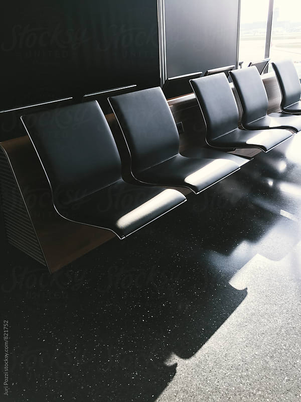 contemporary lounge with seats in the airport by Juri Pozzi for Stocksy United