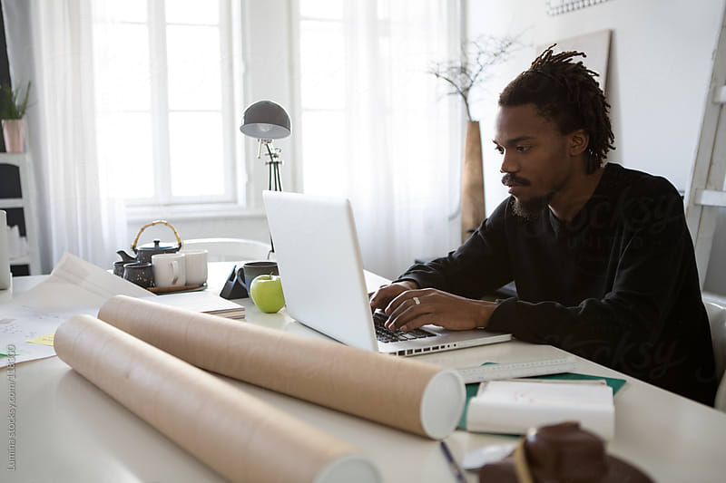 African Architect Working at His Office by Lumina for Stocksy United