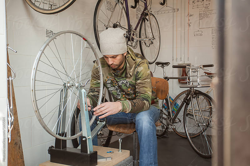 Man Working in a Bicycle Shop by Mosuno for Stocksy United