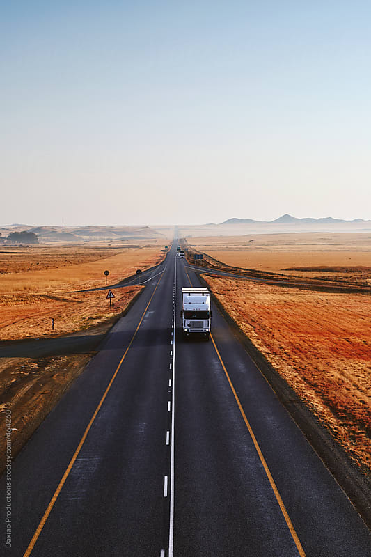 Truck on highway by Daxiao Productions for Stocksy United
