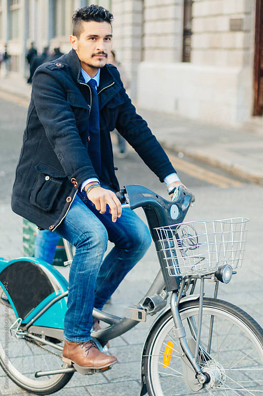 Businessman commuting on Bicycle by Good Vibrations Images for Stocksy United
