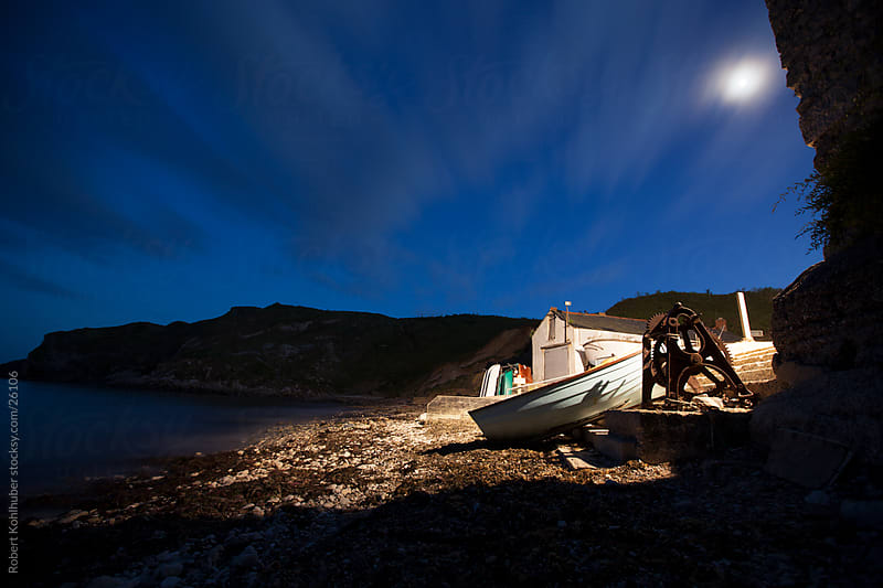 Small harbour in england at night by Robert Kohlhuber for Stocksy United