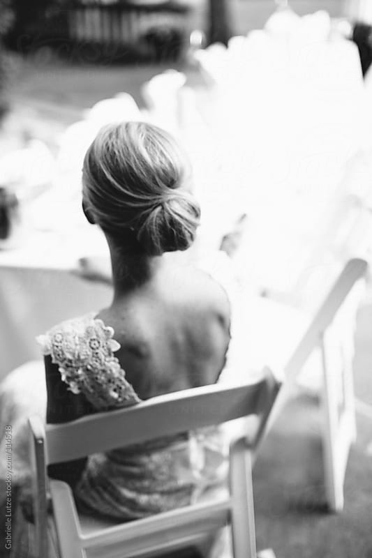 Bride Sitting at Table in Black and White by Gabrielle Lutze for Stocksy United