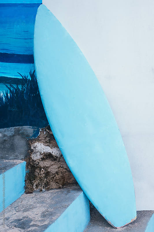 Blue Surfboard Leaning Against House Facade by Alexander Grabchilev for Stocksy United