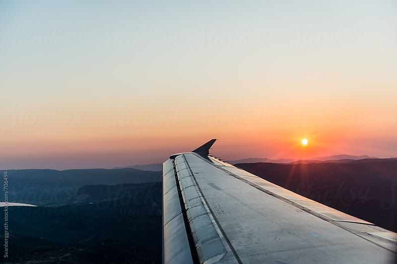 Sunset from Plane Window by Svanberggrath for Stocksy United