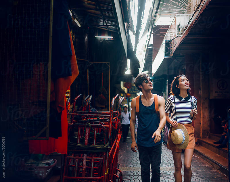 Couple Strolling Around Bangkok by Lumina for Stocksy United