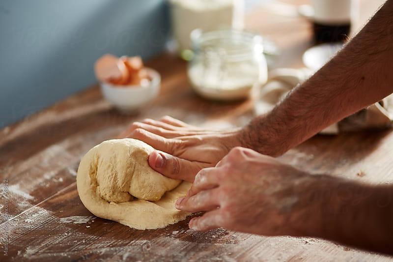 Preparing bread dough by Martí Sans for Stocksy United