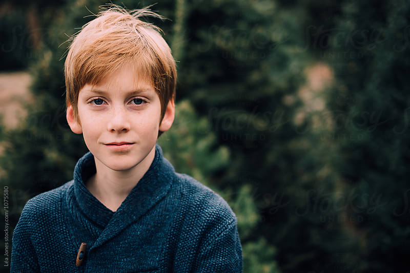redhead teen in christmas tree farm by Léa Jones for Stocksy United