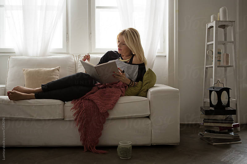 Woman Reading a Book by Lumina for Stocksy United
