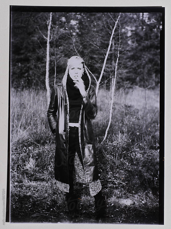 Black and white film shot of stylish woman in forest by rolfo for Stocksy United