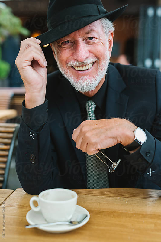 Happy smiling classy senior man portrait by Simone Becchetti for Stocksy United