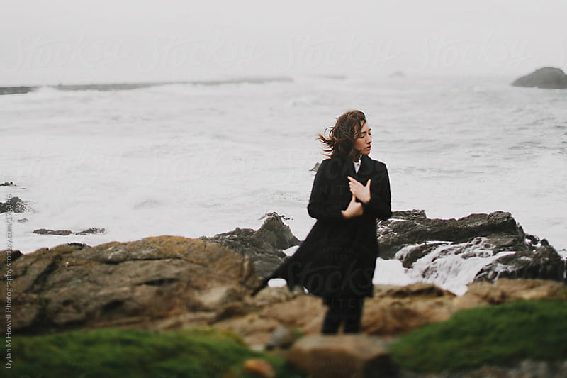 Young girl visiting the coast in winter by Dylan M Howell Photography for Stocksy United