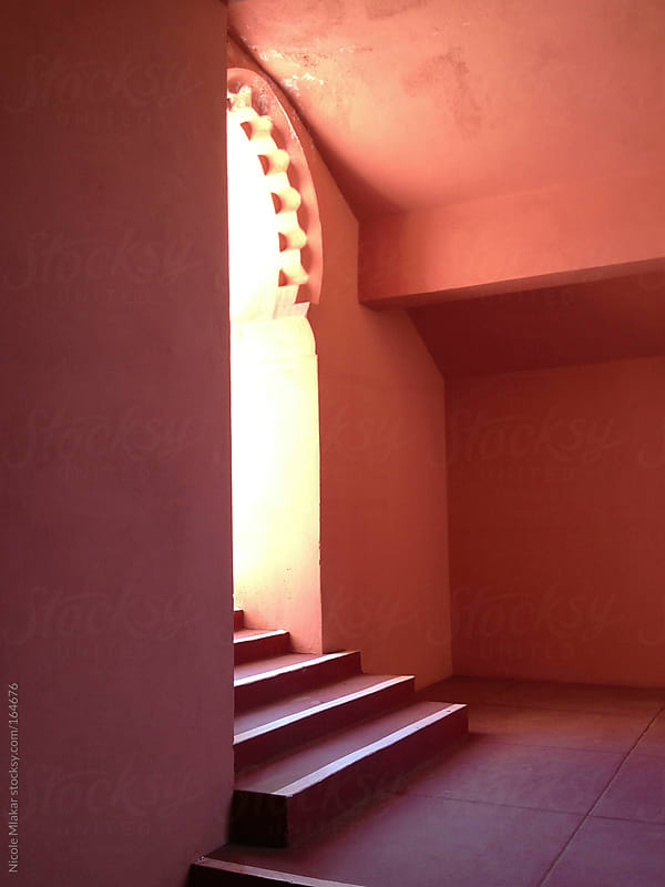 Red and pink entryway in Santa Fe adobe by Nicole Mlakar for Stocksy United