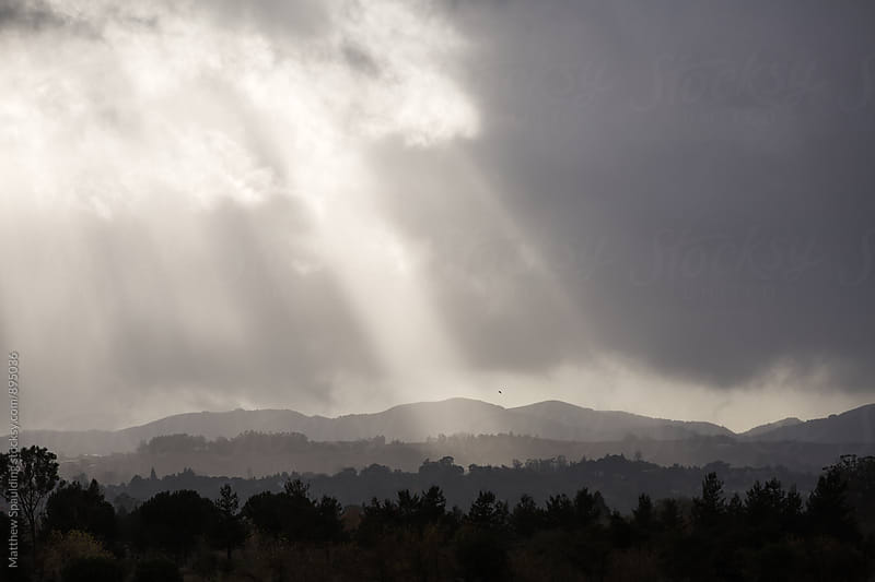 Rays of sunlight in cloudy weather over landscape by Matthew Spaulding for Stocksy United