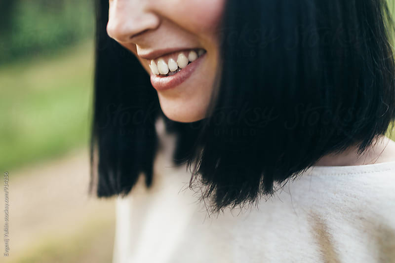 Extremely close-up of smiling girl by Evgenij Yulkin for Stocksy United