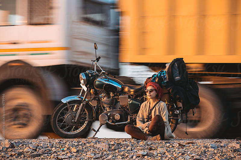 Woman On A Roadside With Motorbike by Alexander Grabchilev for Stocksy United