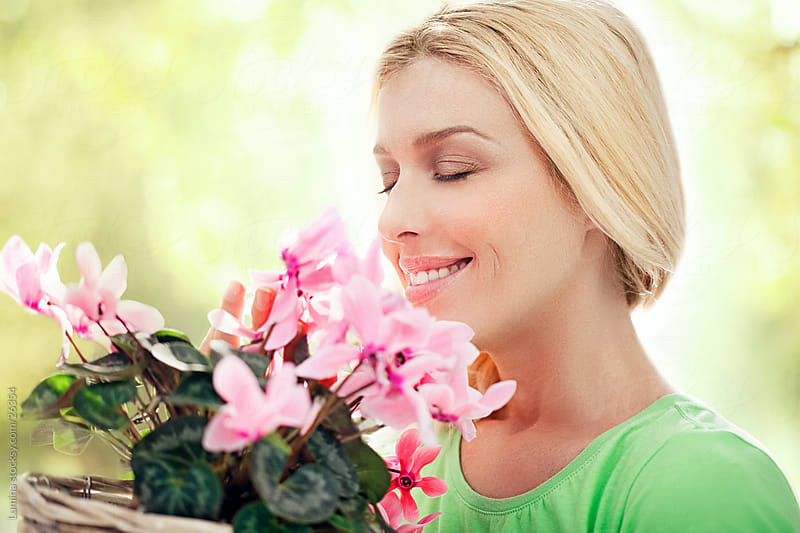 Woman Smelling Flowers by Lumina for Stocksy United