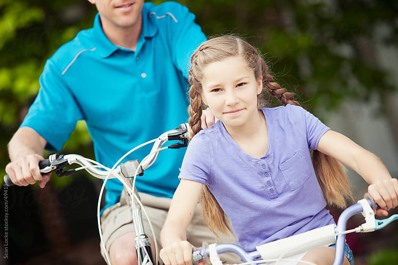 Father: Dad and Daughter Riding Bikes by Sean Locke for Stocksy United