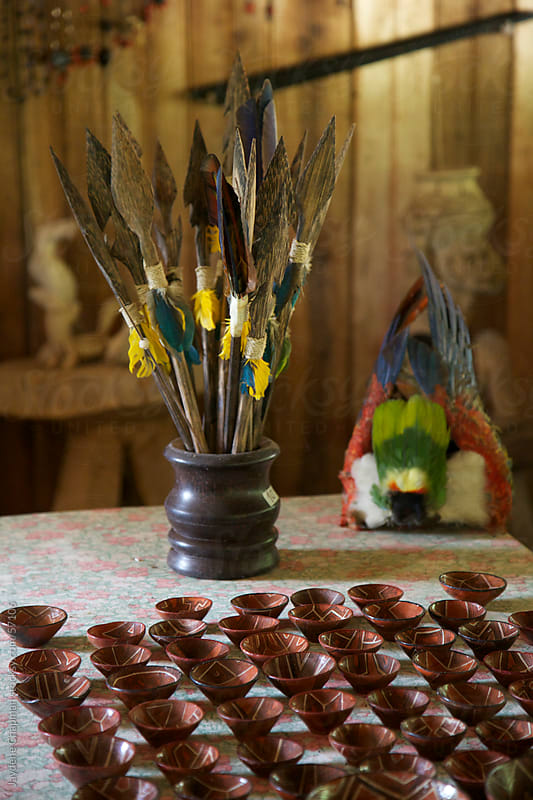 Handmade jungle spears in a jar on a table with rows of pottery, Banos, Ecuador by Jaydene Chapman for Stocksy United