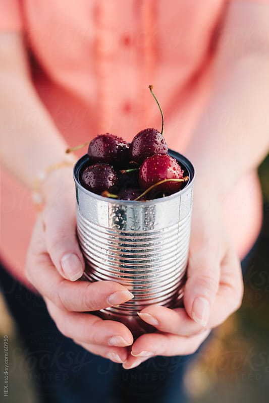 Woman Holding Cherry Can by HEX . for Stocksy United
