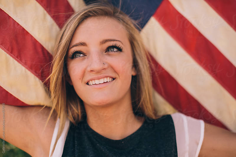 Girl with American Flag by Gabrielle Lutze for Stocksy United