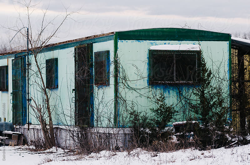 forgotten green trailer in winter by Deirdre Malfatto for Stocksy United