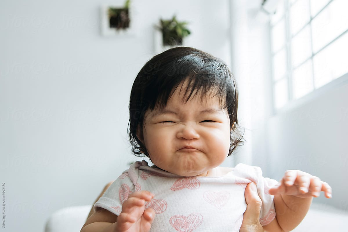 f657a81d5 Stock Photo - Baby Girl Making Funny Face