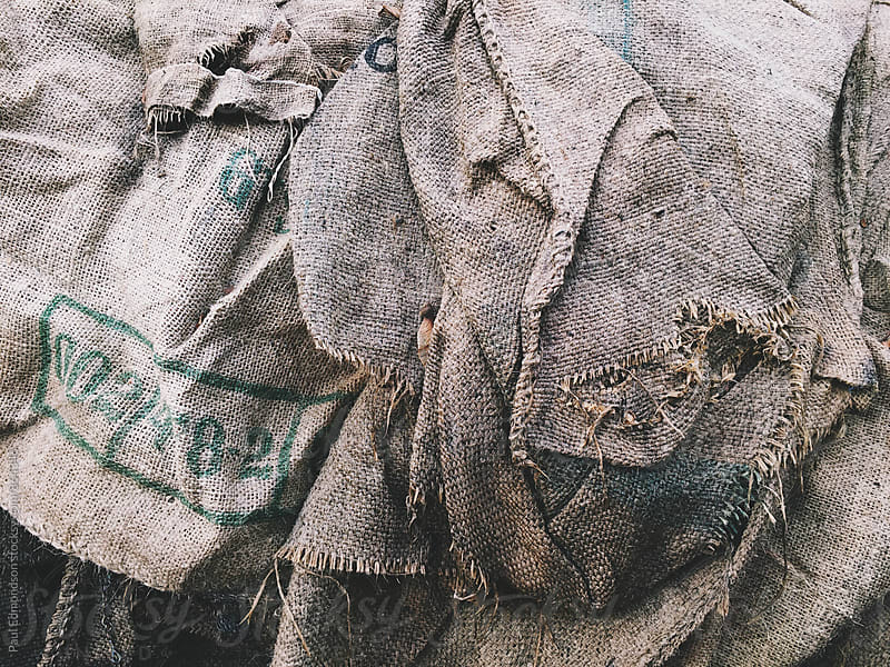 Close up of worn burlap bags by Paul Edmondson for Stocksy United