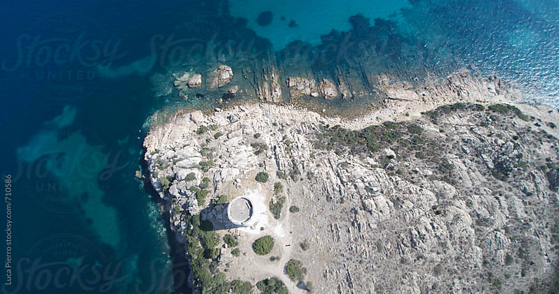 Teulada, Sardinia: aerial view of Spanish tower and harbour by Luca Pierro for Stocksy United