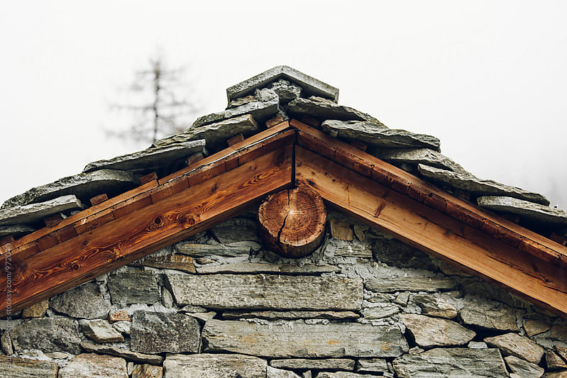 roof detail of a rural stone cabin by Jordi Rulló for Stocksy United