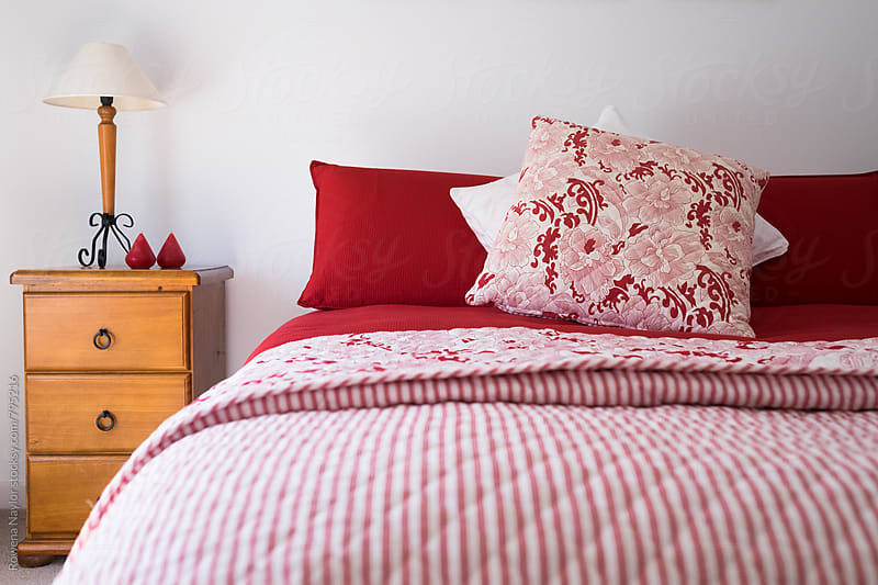 Red & White Bed linen and comforter by Rowena Naylor for Stocksy United
